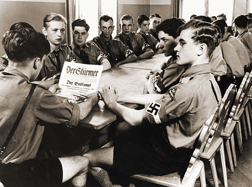 The socialization of the Hitler Youth emphasized group cohesion, selflessness, and hostility to the outgroup