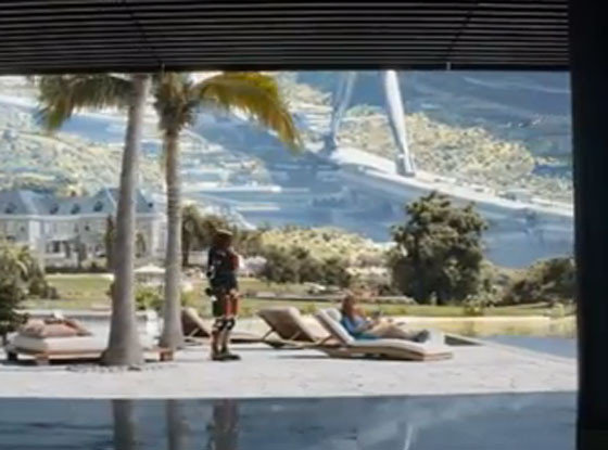 Life in Elysium: Poolside with a robot waiter.