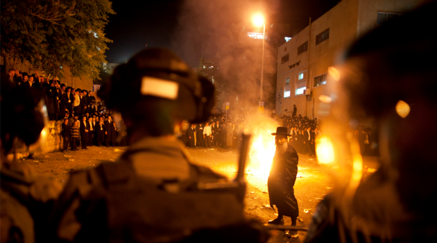 Forward caption: getty images War in the Street: Ultra-Orthodox demonstrators set fires during a protest against Israeli government moves to scrap their exemption from national service.