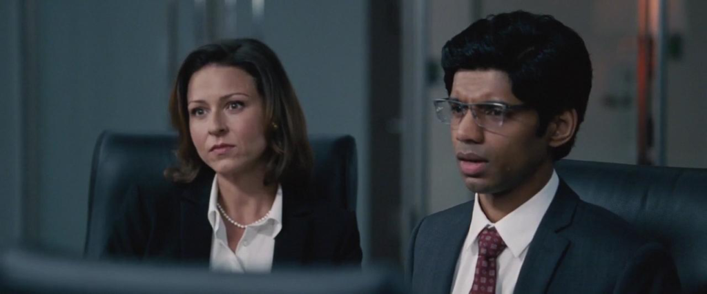 Vanessa Cloke and Rajeev Jacob as Goldman Sachs Employees