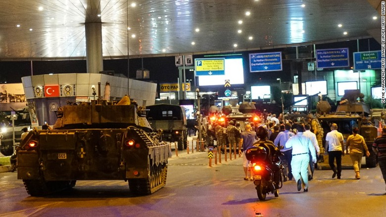 Military vehicles enter Istanbul Ataturk Airport following an attempted coup attempt in Turkey