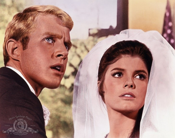 Carl Smith (Brian Avery) with Elaine (Katharine Ross)