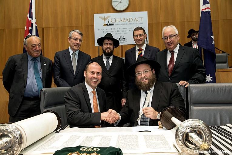 Australia's current Treasurer Josh Frydenberg (front left)