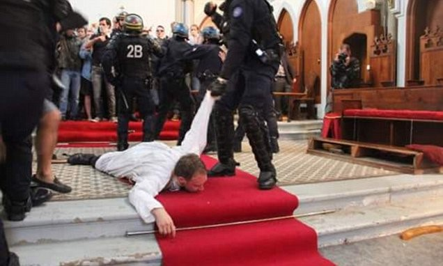 Abbot Guillaume dragged from St Rita church, Paris by riot police in 2016