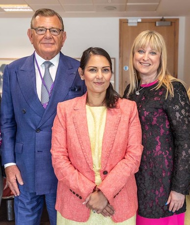 A cuckservative and her controllers: Priti Patel with convicted Jewish fraudster Sir Gerald Ronson and Jewish Board of Deputies leader Marie van der Zyl
